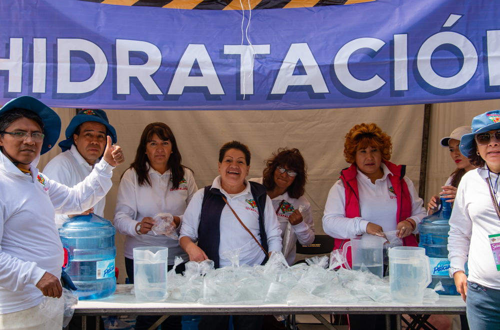 Volunteers handing water