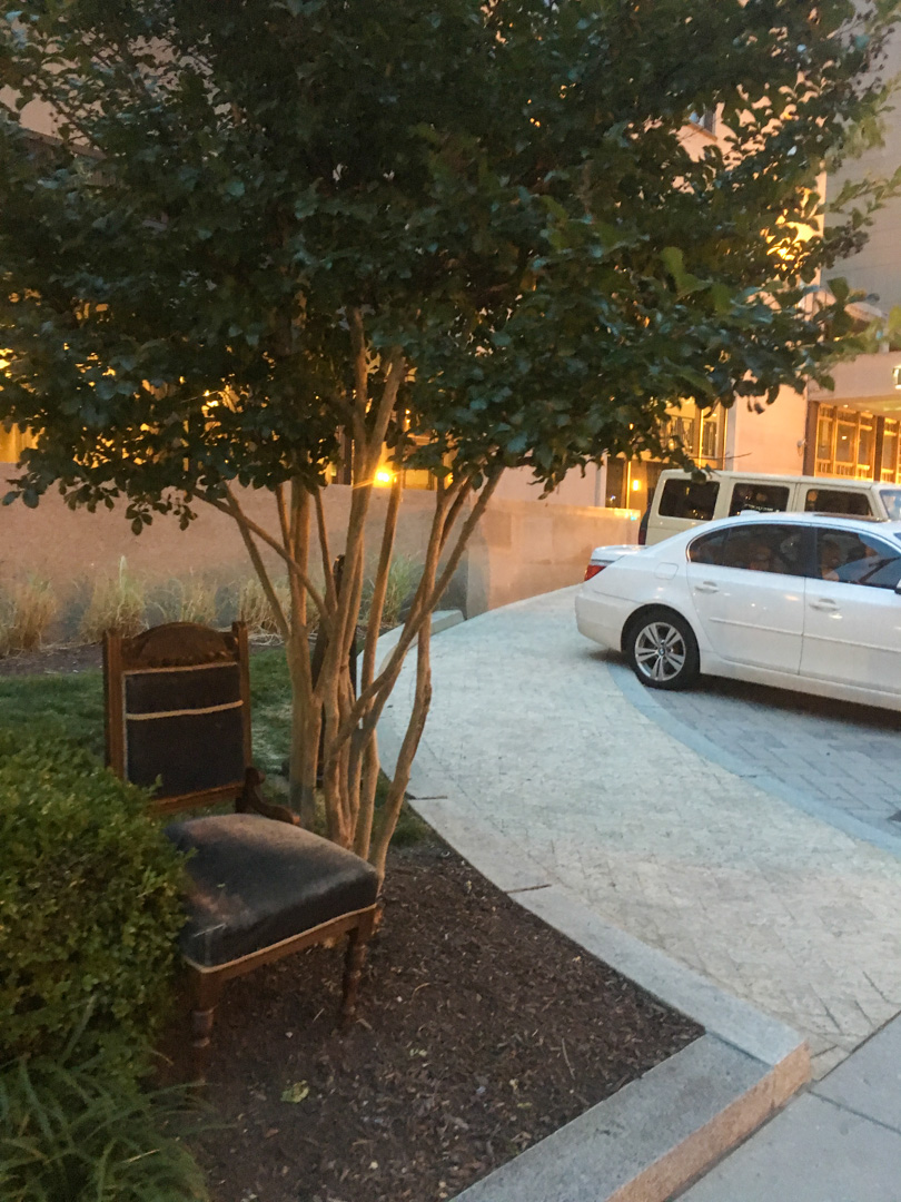 By hotel driveway